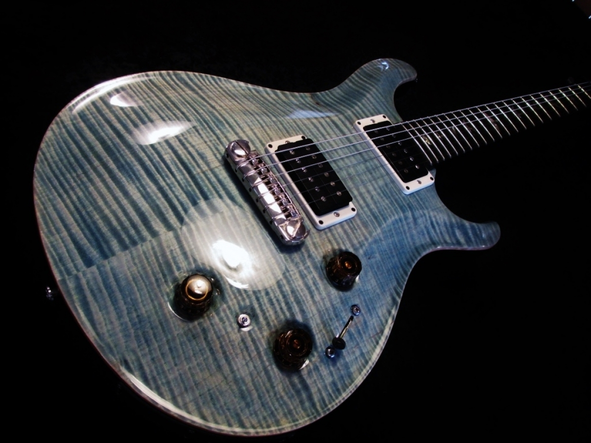 PRS Colour Change From a Tiger Burst to Whale Blue/Faded Denim Blue also added natural binding to the side.